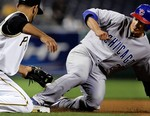 Theriot knocks out the ball 4-10.jpg